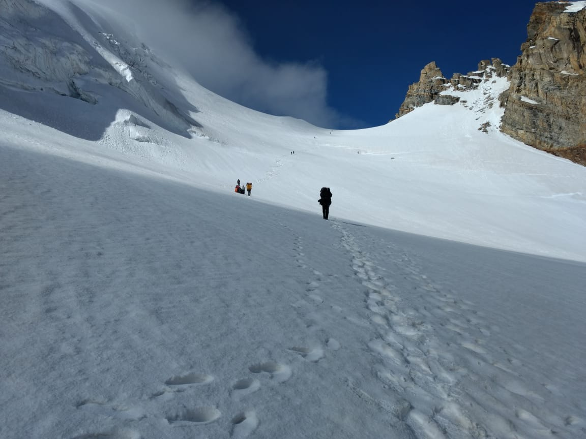 trekker walking on snow in audens col trek