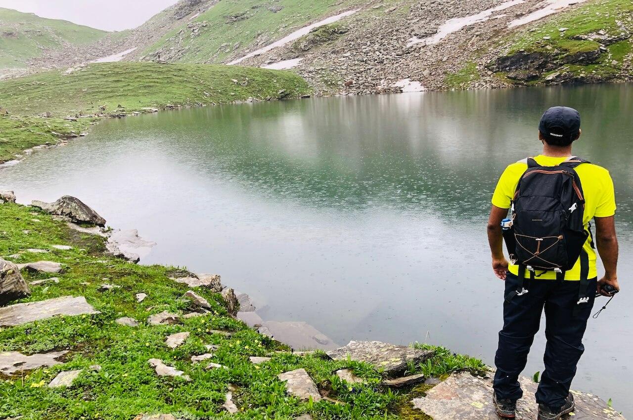 man standing near bhrigu lake