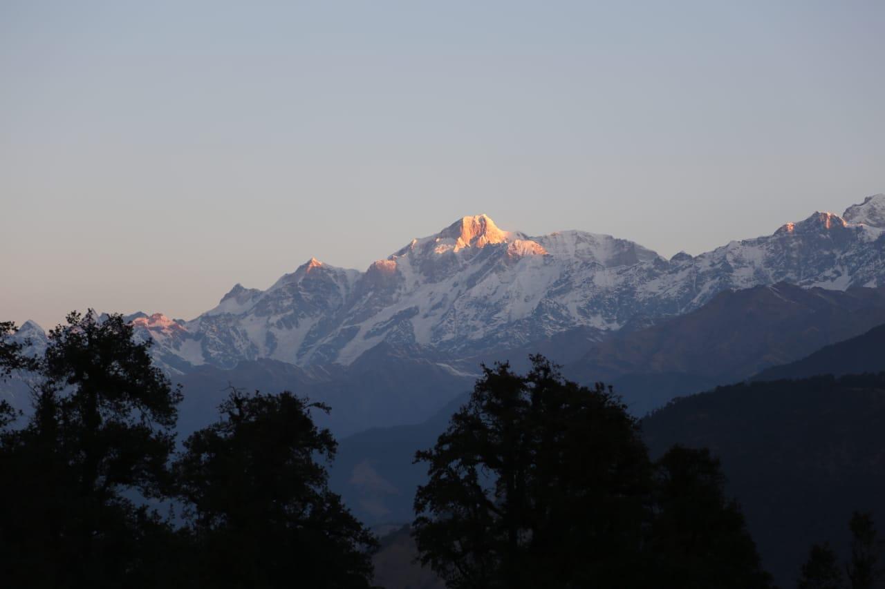 mountain peak glowing in orange colour from sunlght