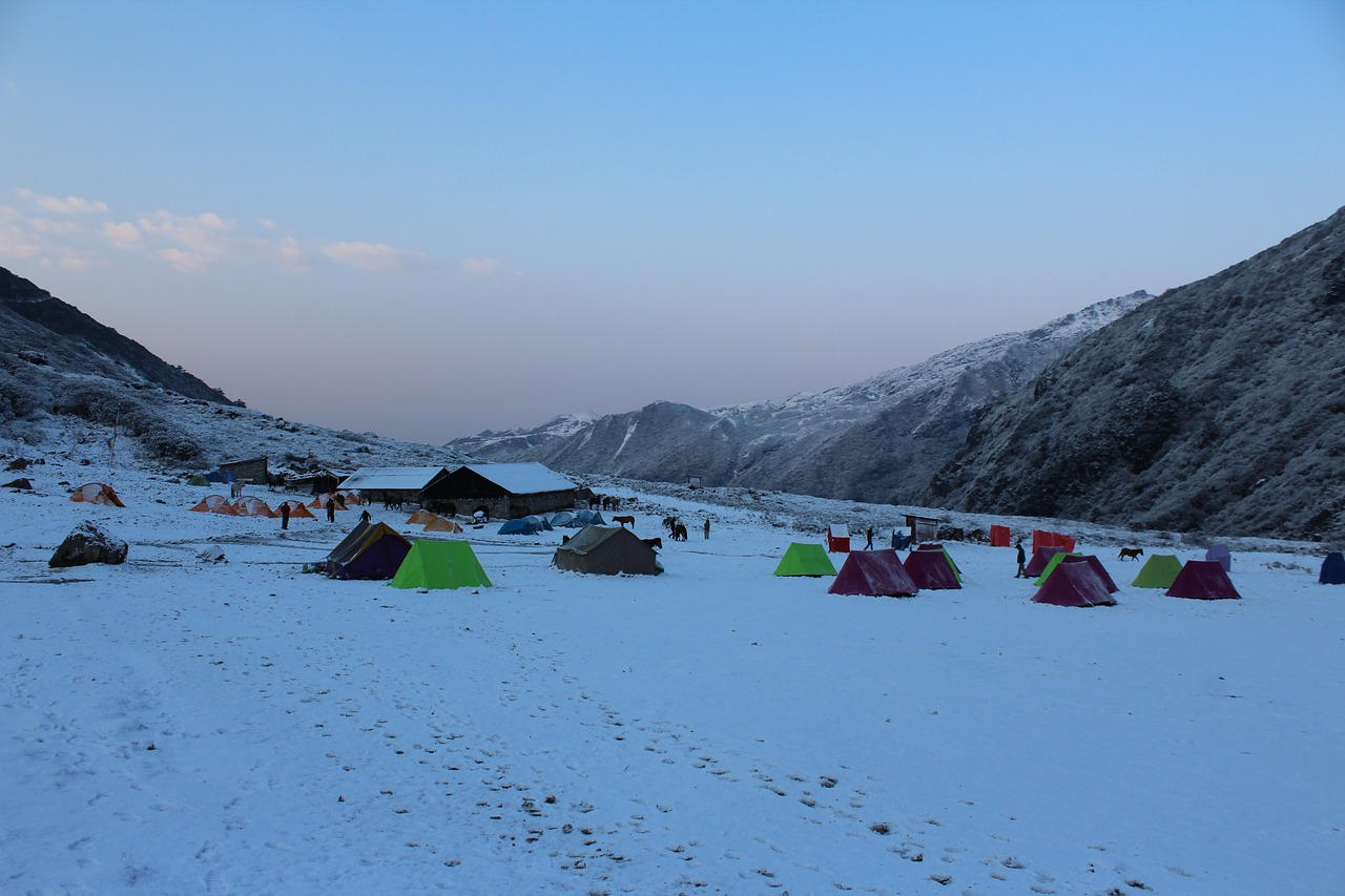 colour tents pitched at campsite on goechala trek