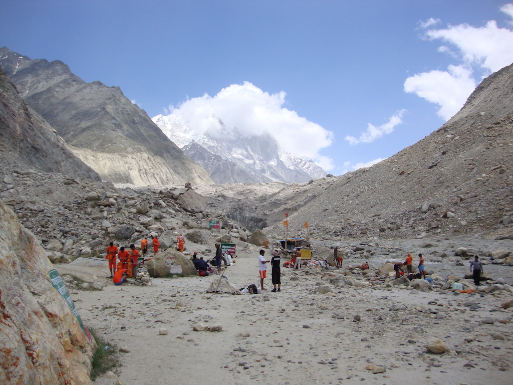 people standing near river gangotri at gomukh trek