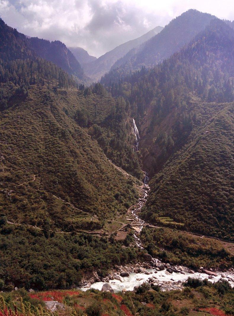 waterfall through the valley enroute har ki dun