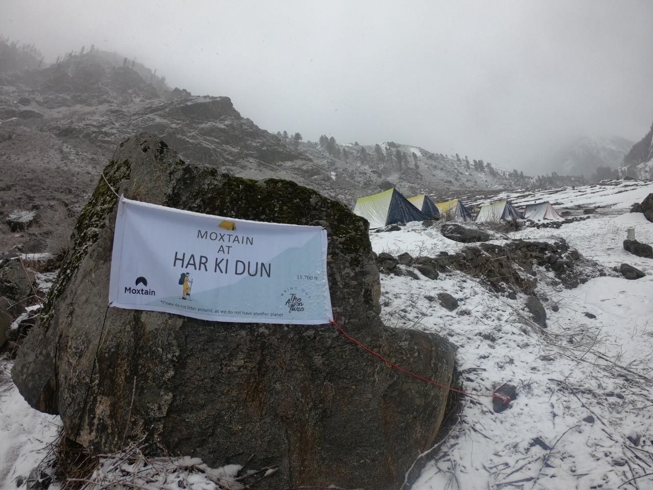 tents at har ki dun campsite cover with snow