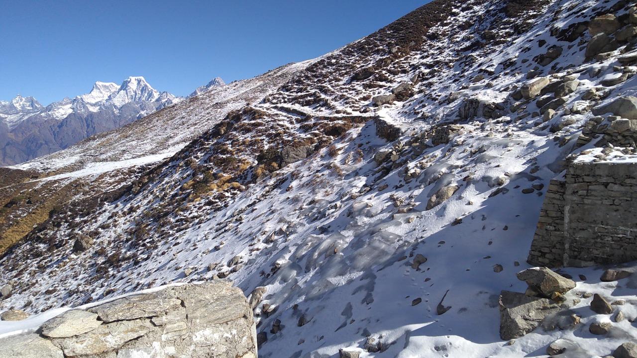 snow covered mountains enroute kuari pass