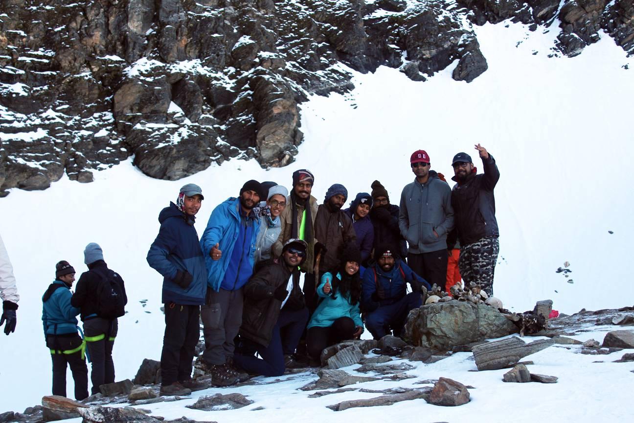 trekkers standing over the piles of bones on roopkund trek