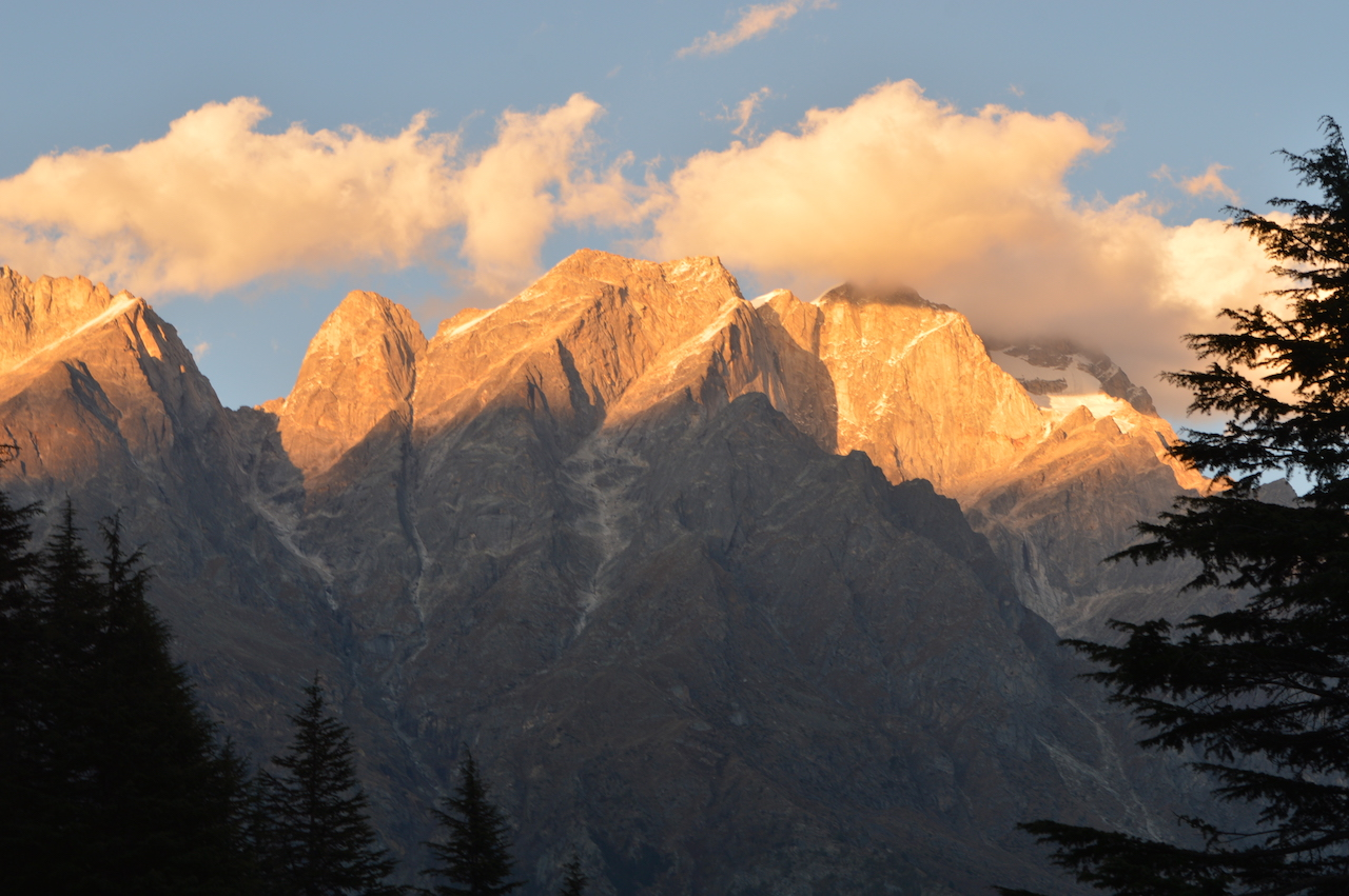 mountain peaks glowing with the light of sun
