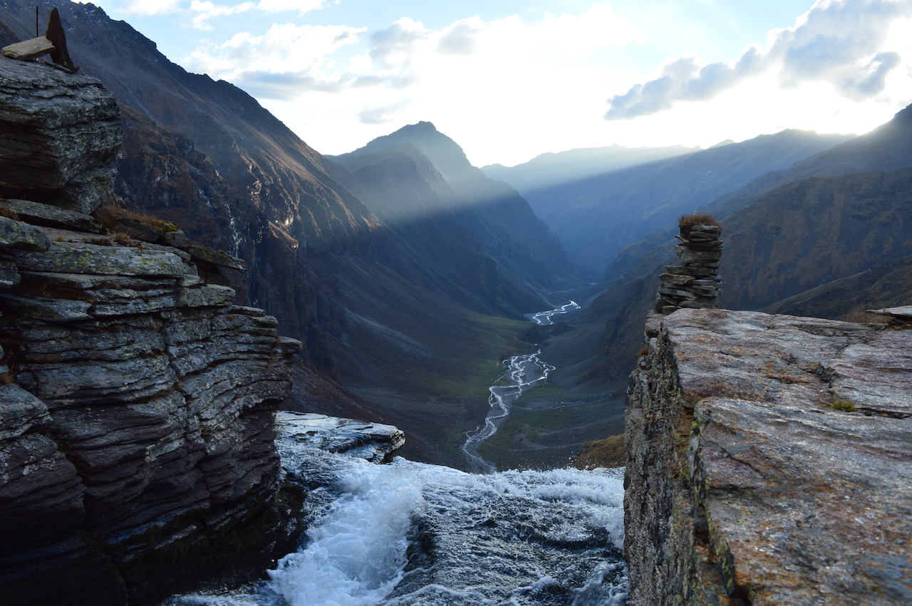 water droping from upper waterfall at rupin pass passing through the valley