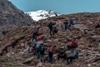 trekkers resting enroute rupin pass